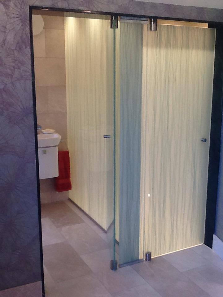 Glass doors of a toilet daedalian glass studios