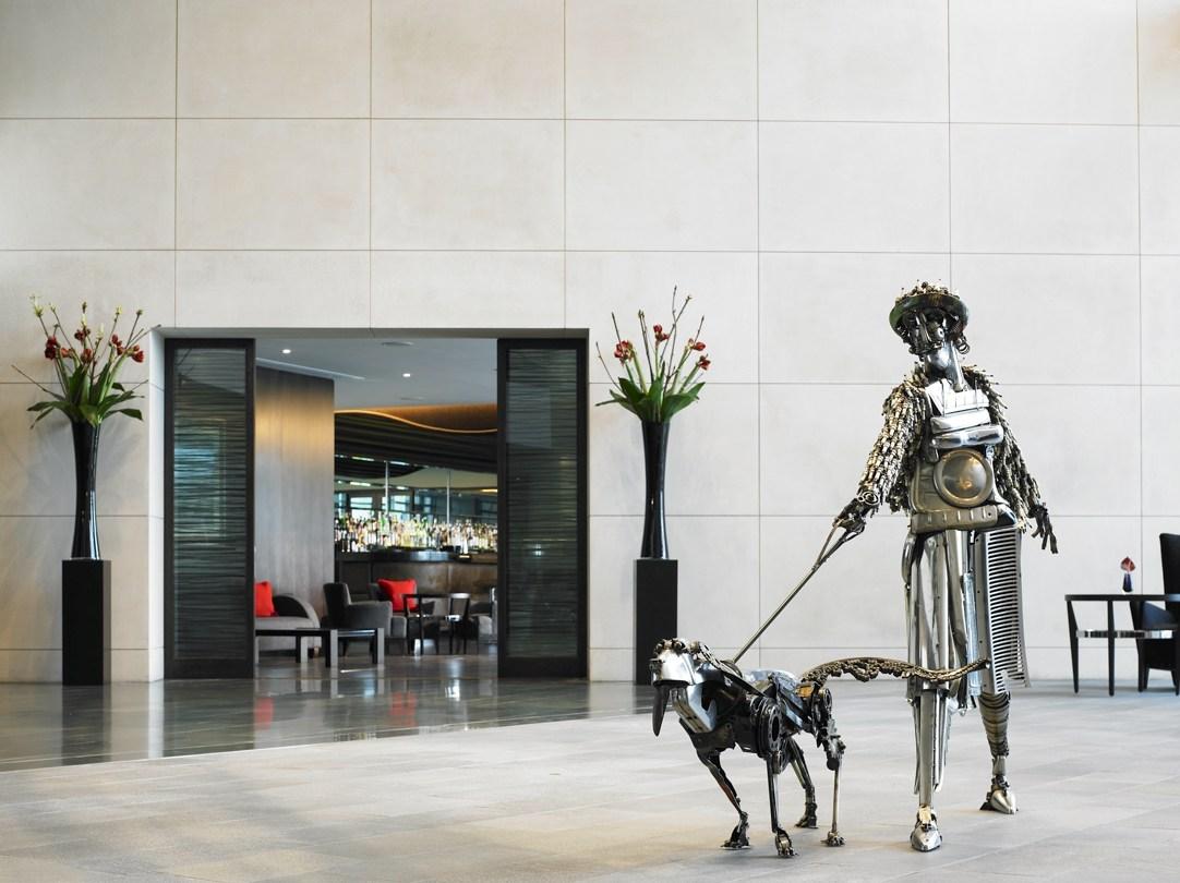 Brooklands exterior with dog walker sculptor and glass screens