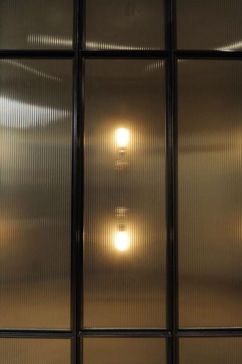Detail of panel showing designer lighting