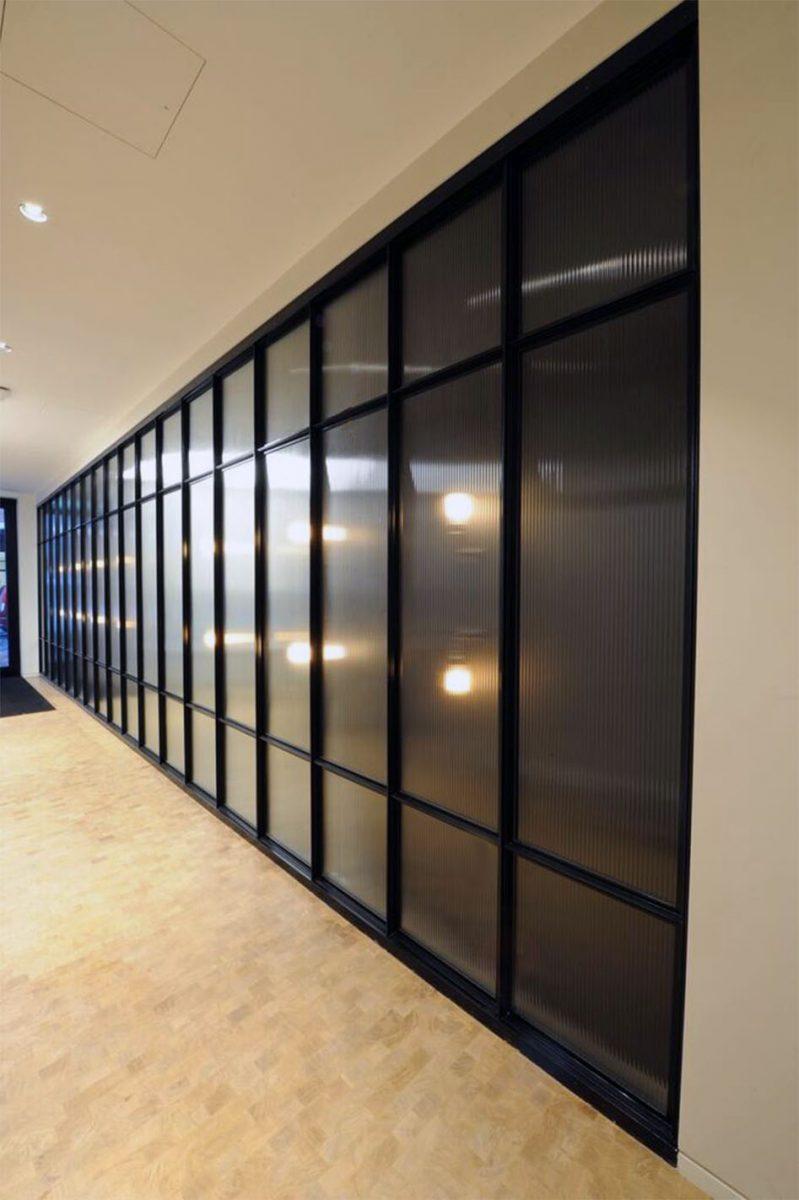 Mild Steel framed panels to entrance lobby